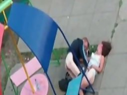Drunk couple on a playground