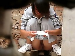 Chinese girl crouching down