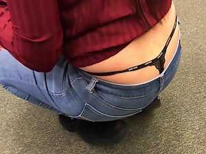 Thick girl's thong is sticking all the way out of jeans