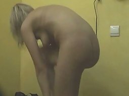 Blonde naked and preparing for tan