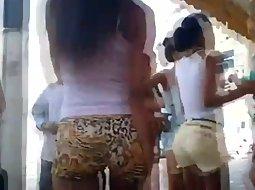Petite girl in leopard shorts