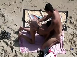 Great beach sex spied from a cliff