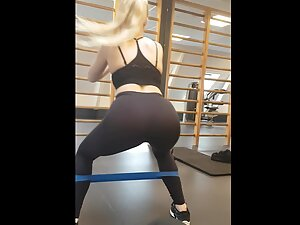 Hot blonde shows a lot of her ass during exercise