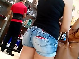 Sweet butt of a girl in the store