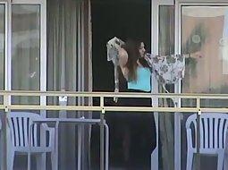 Neighbor girls tits on the balcony