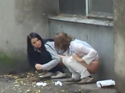 Teen girls caught pissing outside