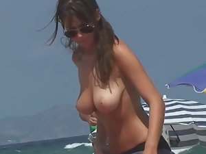 Perfect low hanging tits on the beach