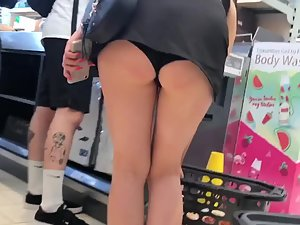 Slutty girl bends over and reveals ass in upskirt