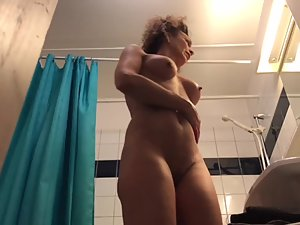 Spying on fit mature woman checking herself