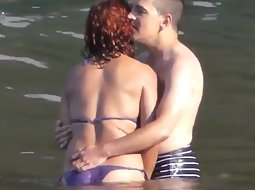 Horny couple in the water