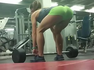Amazing fit ass of girl lifting weights in gym