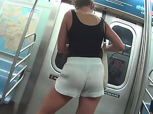 Black thong visible through loose shorts