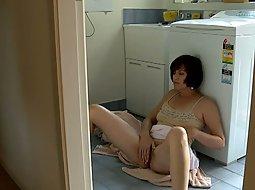 Masturbating while doing the laundry