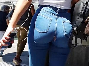 Sexy girl is unaware that her jeans have a hole
