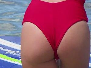 Sexy surfer girl's ass gets wet