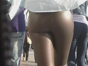 Wet looking ass in leather pants