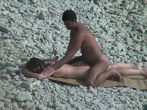 Beach sex masked into back massage