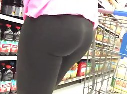 Ass in tights in the store