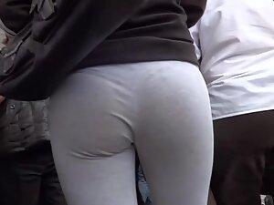 Following a firm round tushy in grey leggings