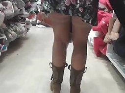 Cute girl in a shoe store