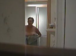 Mother steps out of the shower