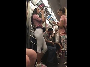 Sexy commuter caught in subway by voyeur