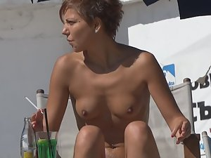 Beautiful young topless tits on beach