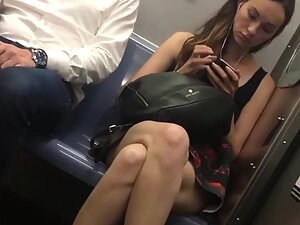 Upskirt of slim cutie from the train