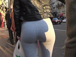 Magnetic appeal of tight ass in grey leggings