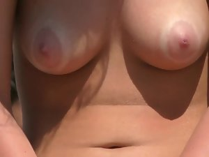 Tan line around nipples of gorgeous breasts