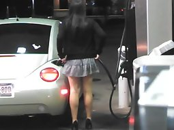 Sexy girl on the gas station