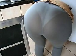 My wife bent over in the kitchen