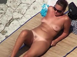 Hot naked milf on a beach