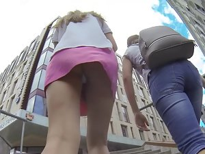 Upskirt of a leggy girl in pink miniskirt