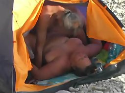 Big woman fucked in a beach tent