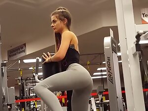Powerful ass cheeks in tight grey leggings