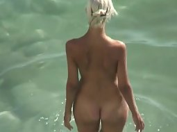 Stunning blonde fucked after a swim