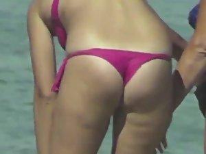 Sexy milf in pink bikini thong