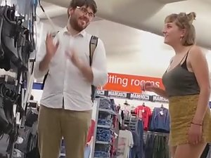 Upskirt while hipster couple is buying boots