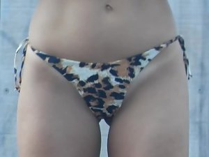Provocative milf in thong bikini with leopard pattern