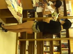 Sexy girl in the book store