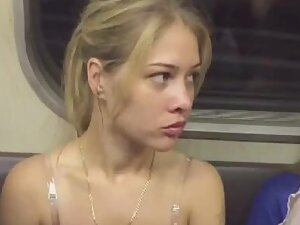 Upskirt of blonde darling in subway train