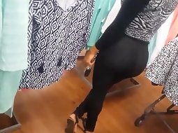 Bubbly butt latina in clothing store