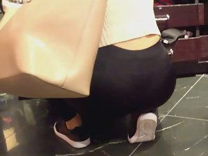 Woman gets down on all fours in the store