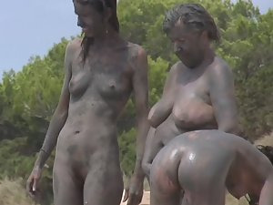 Dirty naked girls covered in mud