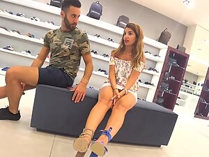 Sexy girl's long legs and upskirt in shoe store