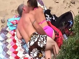 Milf getting fingered at the beach