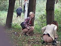 women pissing in the park