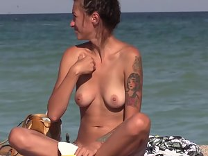 Tattooed nudist girl got a shaved snatch