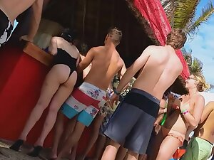 Slutty girl knows what she is doing in a beach bar